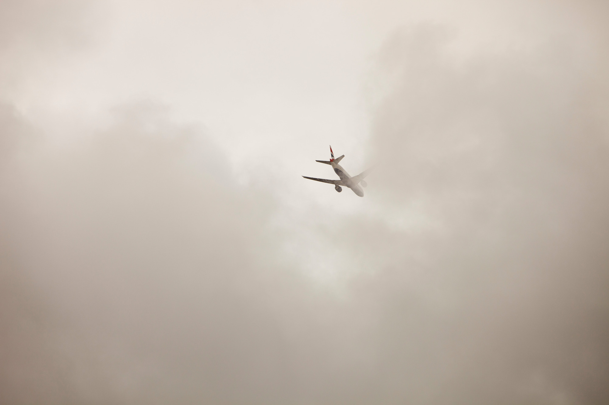 A plane flying into cloud over London