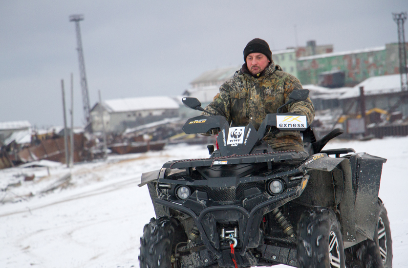 Yuri Popovich patrolling on a quad bike, Amderma, Russia