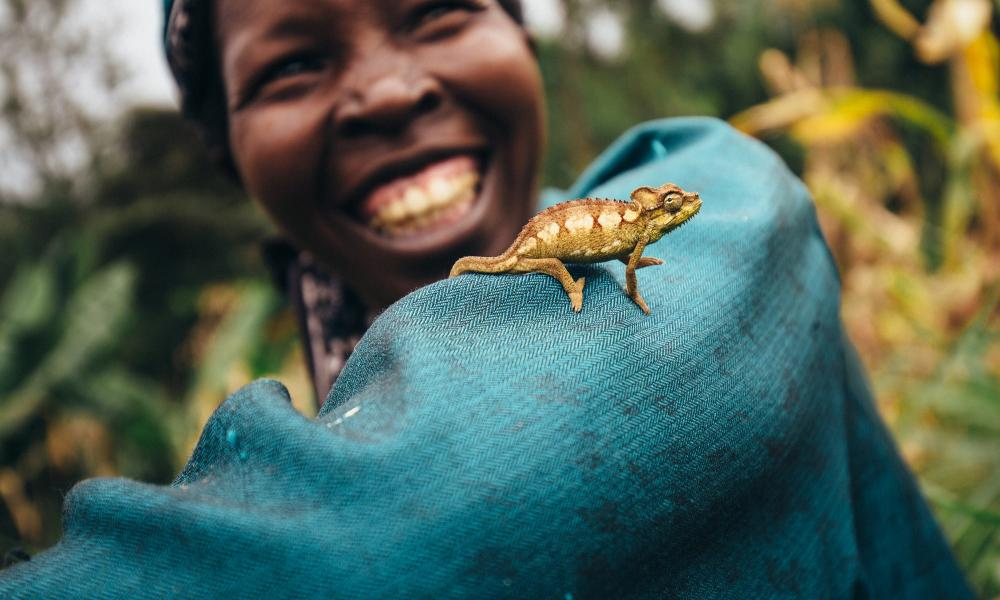 Nancy Rono, Farmer, on her farm with cameleonon on her arm. Bomet County, Mara River Upper Catchment, Kenya