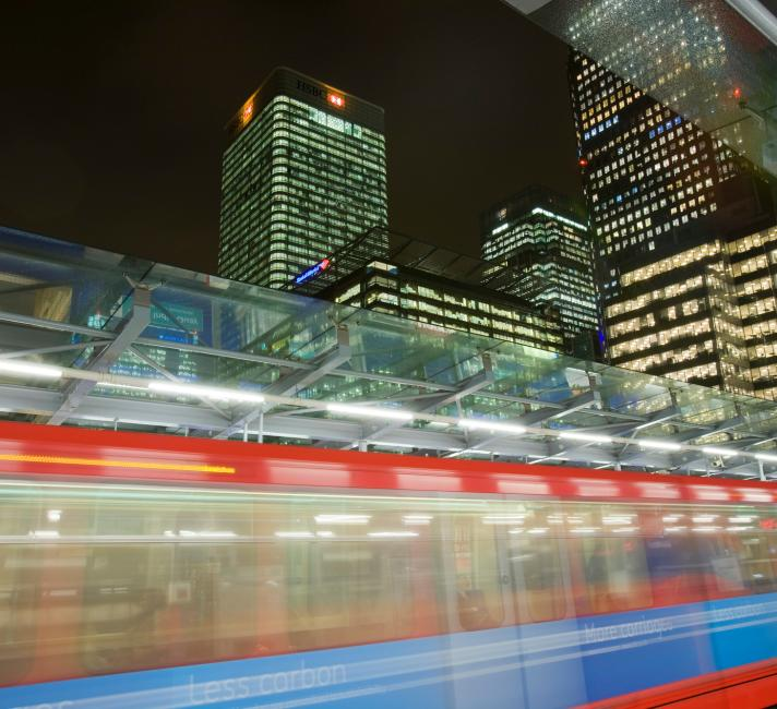 Banking and financial sector buildings are seen from the Docklands Light Railway at Canary Wharf, London, UK.