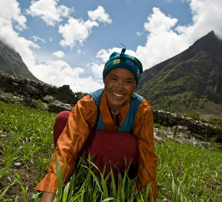 A local Tamang woman working in a field