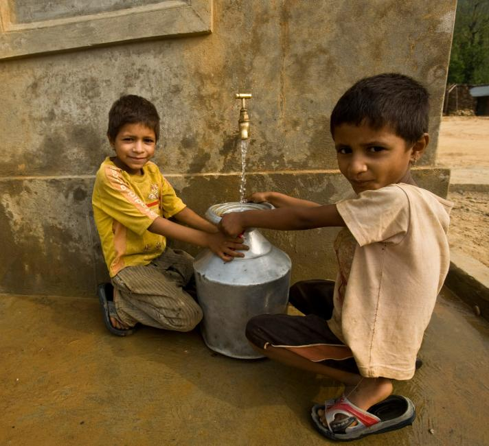 Children collecting spring water.
