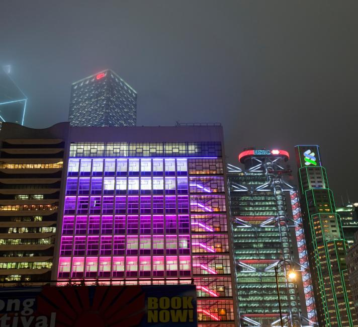 Office blocks lit up at night in Hong Kong, China.