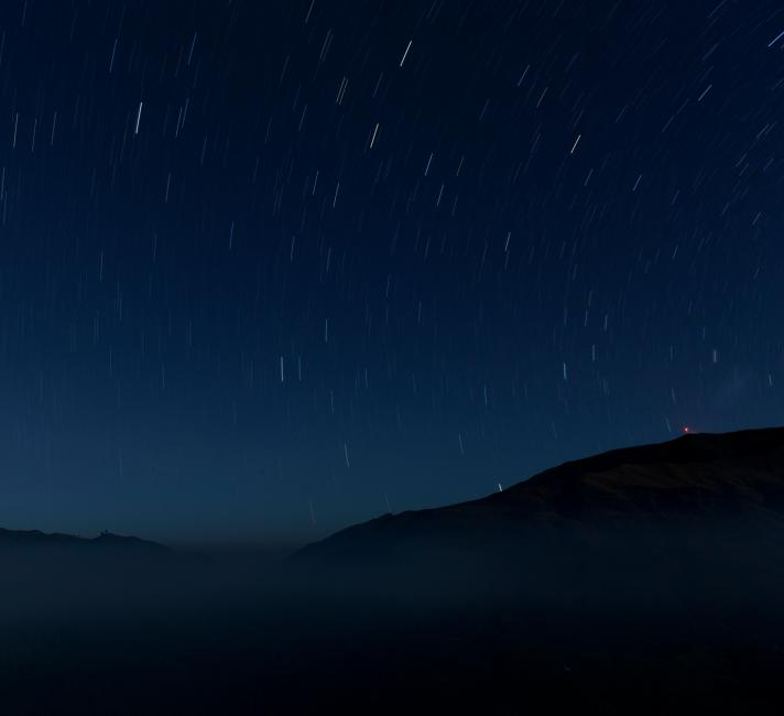 Night shot of the skies of Maubisse with star streaks.