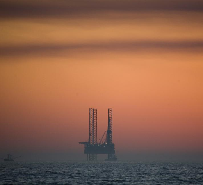 An oil rig off of the coast