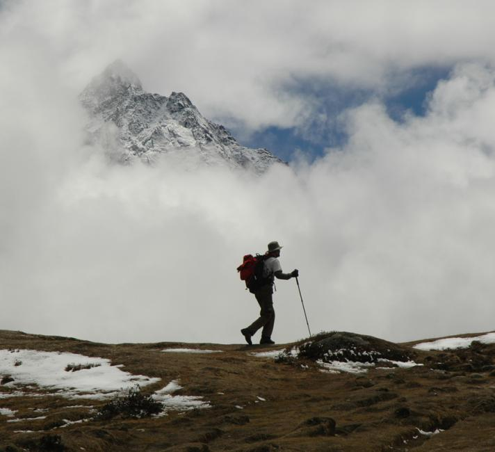 A lone trekker on a trail in the Himalayas near Mount Everest, Nepal.