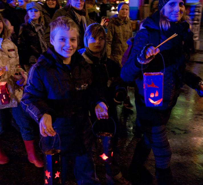 Danish children carrying lanterns through the darkened streets as part of the Earth Hour 'Hopenhagen' event.