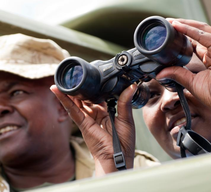 Rangers looking through binoculars