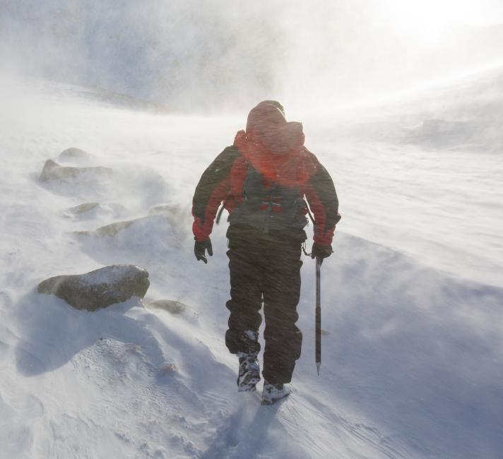 A climber battles blizzards and drifting snow