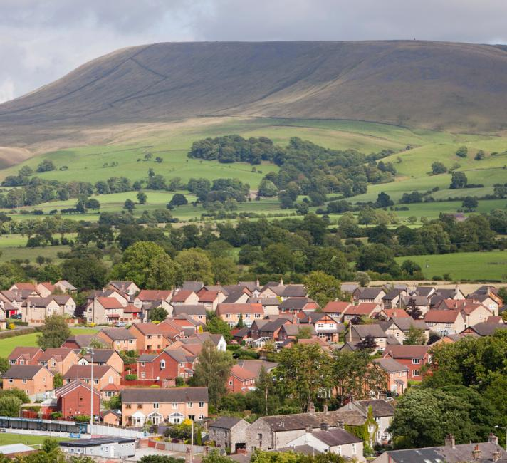 Houses on the outskirts of Clitheroe, Lancashire, UK, looking towards the surrounding countryside and Pendle Hill.
