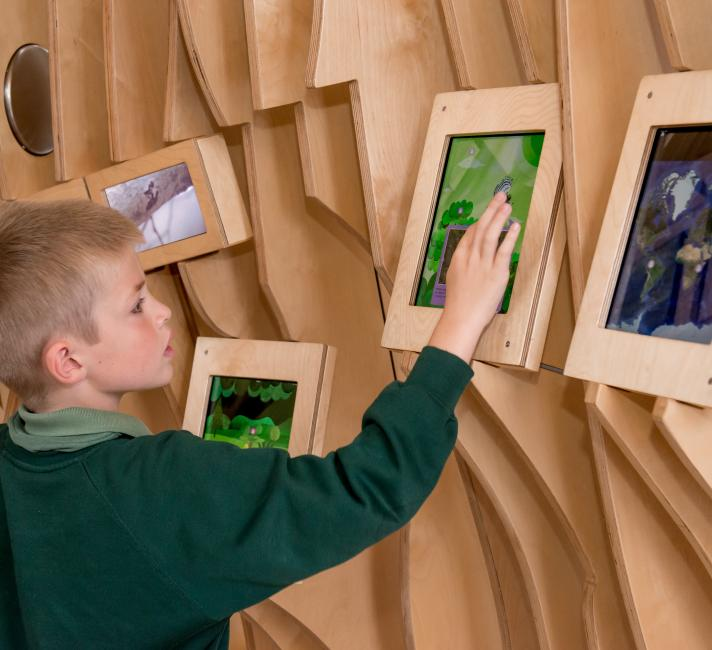 Pupil exploring the WWF Experience at the Living Planet Centre © Richard Stonehouse / WWF-UK