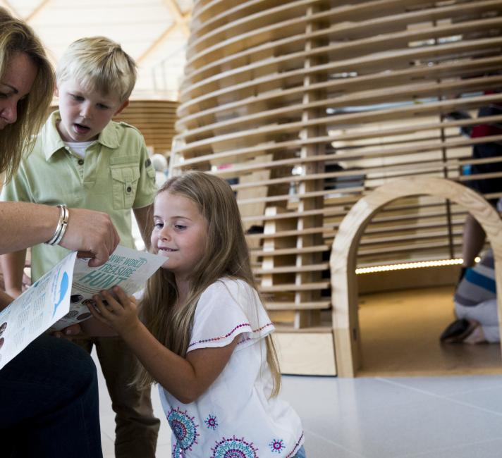 A Family exploring the WWF Experience visitor centre © Richard Stonehouse / WWF-UK