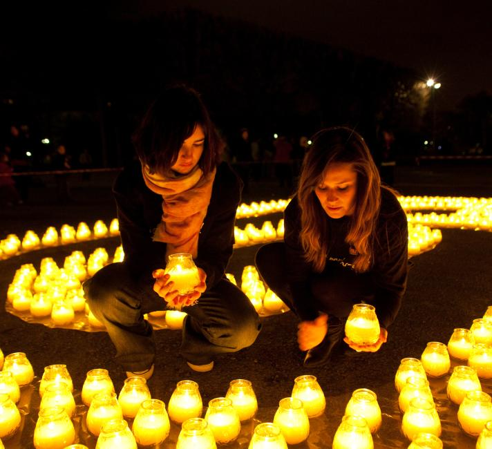 Girls lay out candles for Earth Hour