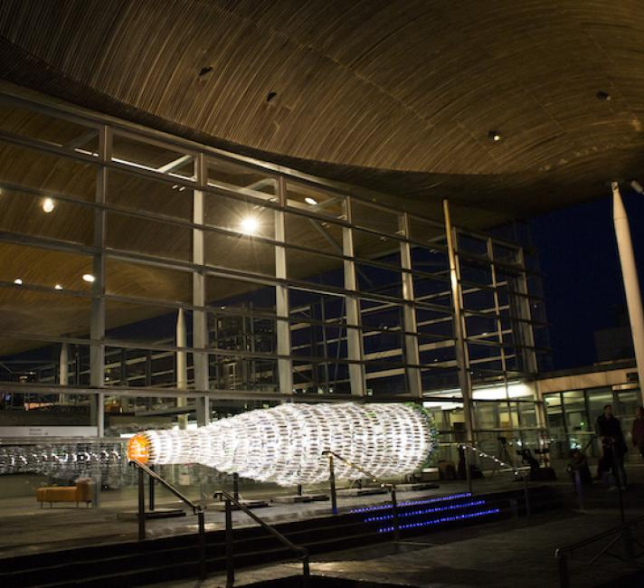 Giant message in a bottle outside the Senedd
