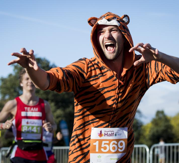 Royal Parks Half Marathon runner in tiger costume