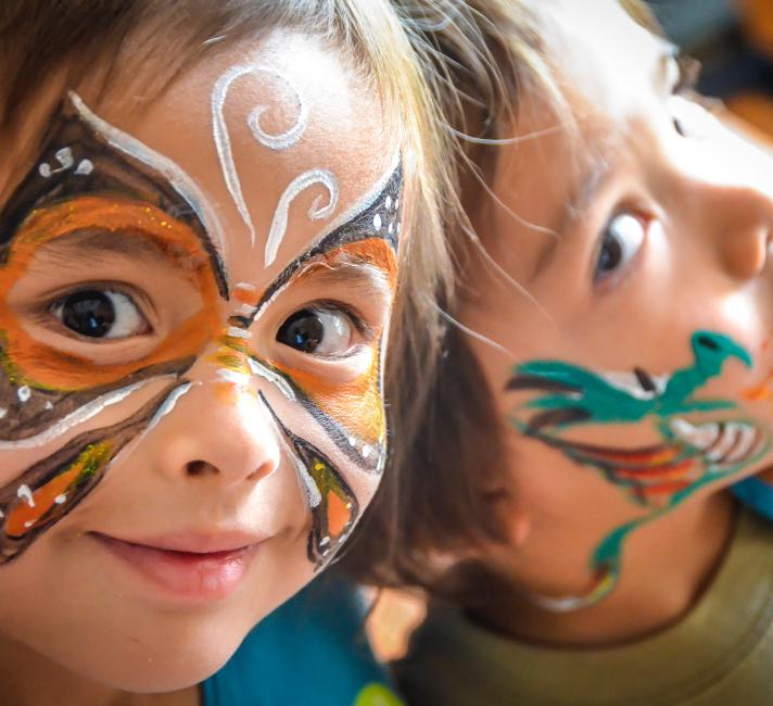 Children with animal themes painted faces.