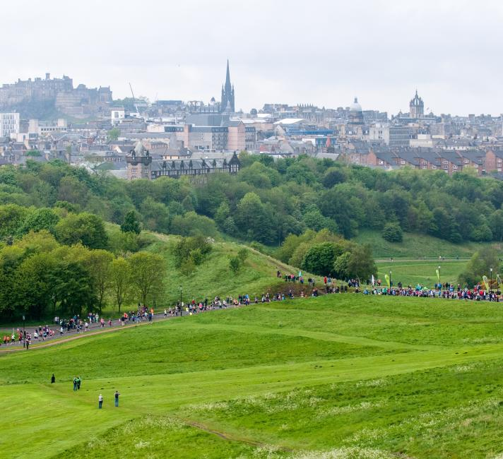 Landscape view of runners in Edinburgh