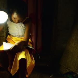 Girl with solar lamp
